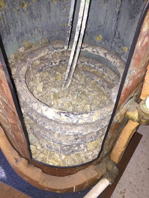 Hot water tank full of lime scale