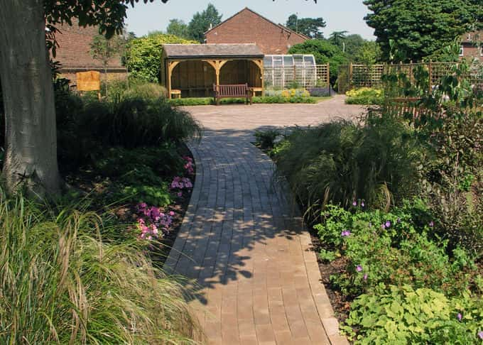 Soft planting along the garden entrance is calming