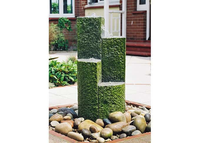 The play of water on solid granite made a striking garden centrepiece