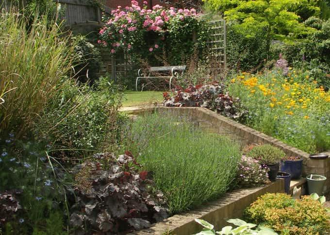 Exuberant planting helps create privacy in an overlooked garden