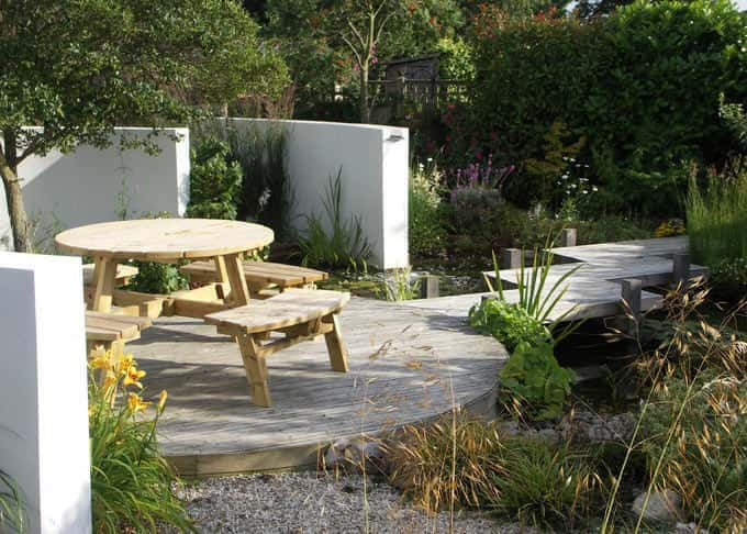 A screened sitting area provides the perfect spot to admire the pond