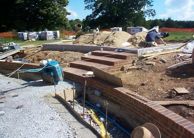 The garden under construction with granite setts and clay bricks fully exposed