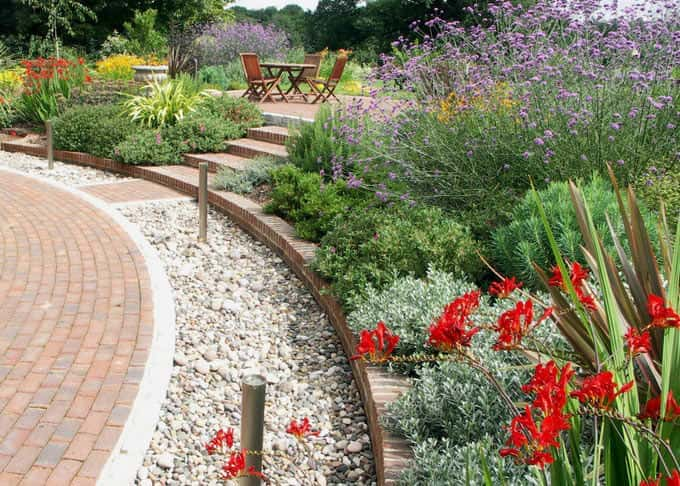 After three years the strong design still defines the space but is now balanced by the planting