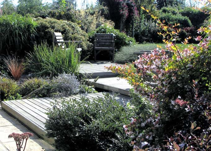 Five years on in summer the deck nestles beautifully into the landscape
