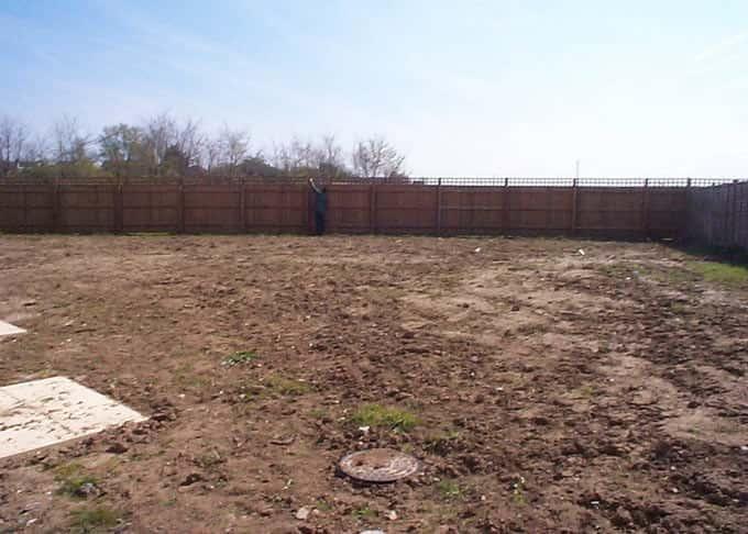 The barren sloping garden before
