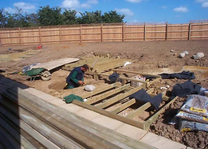 The bones of the deck in place and the stream and pebble pool are under construction