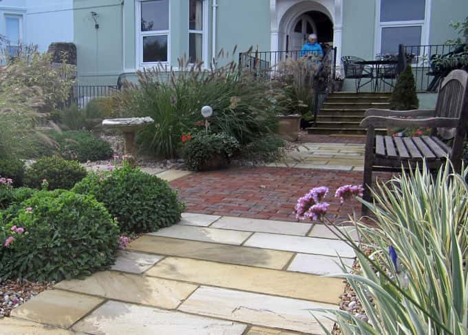Natural sandstone and clay brick paviors contrast beautifully in the new garden path