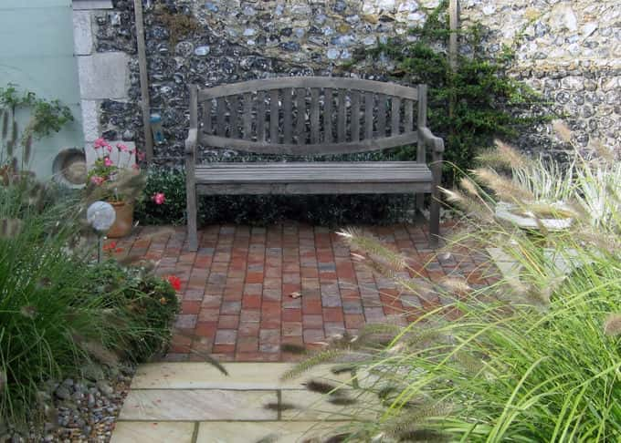 A place to sit and relax by the characterful flint wall