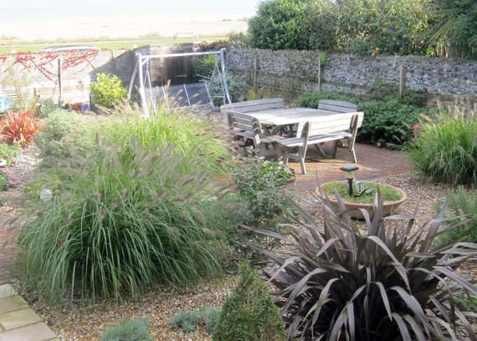 The garden transformed with sea view over the garden wall