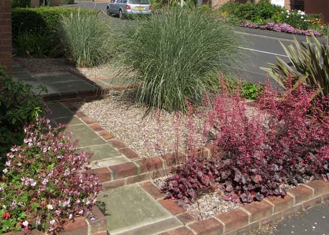 The planting utilises colour, foliage, form and a restricted palette to good effect