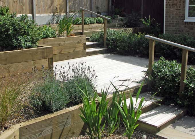 A terraced garden with deck and complimentary timber retaining walls