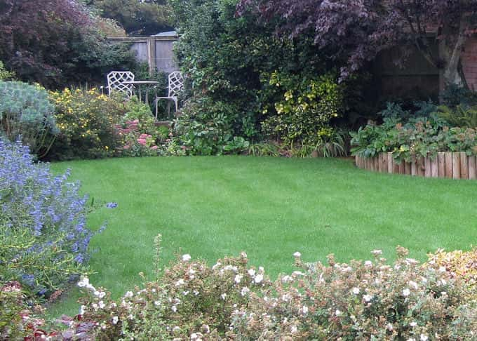 A well laid lawn provides a simple beauty and a space in which to relax or play