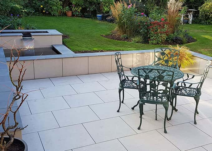 Stylish porcelain unifies patio, retaining walls and water feature