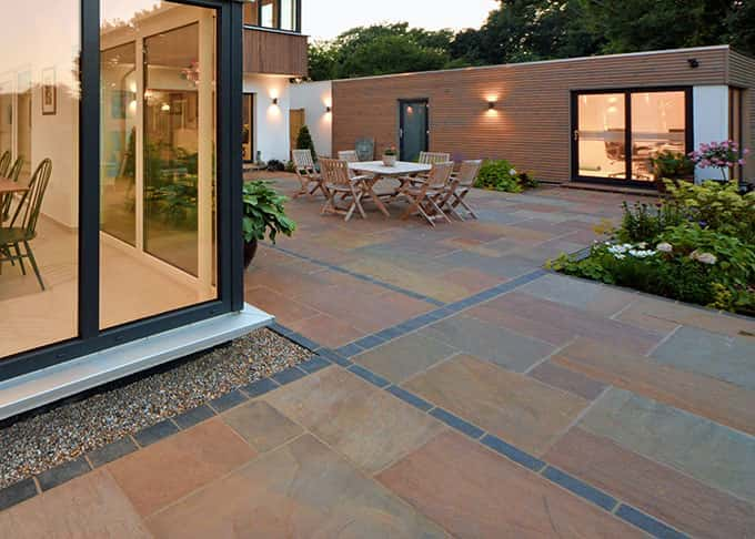 Beautifully detailed sandstone and engineering brick paving compliments this contemporary home
