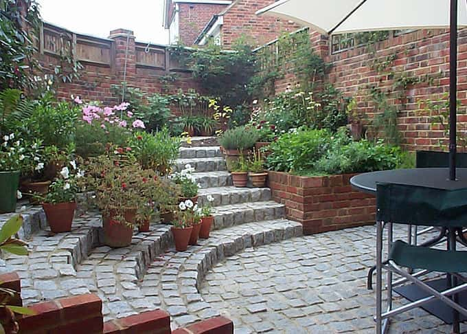 Traditional granite setts in a small walled garden