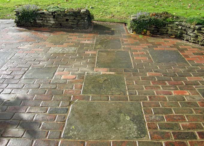 Reclaimed York stone and red brick blend beautifully in an informal design