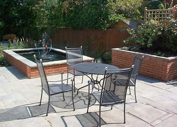 Complimentary coping stones unify the features in this lovely dining space