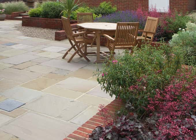Buff sandstone tones are a foil for vibrant planting