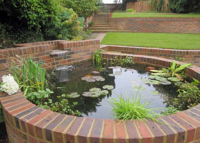 A raised pond is integrated into the garden structure