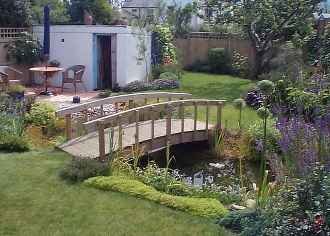 A bridge allows enjoyment of a pond at close quarters
