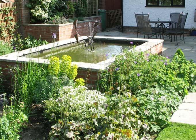 Formal raised pond with bespoke 'Arum' fountain