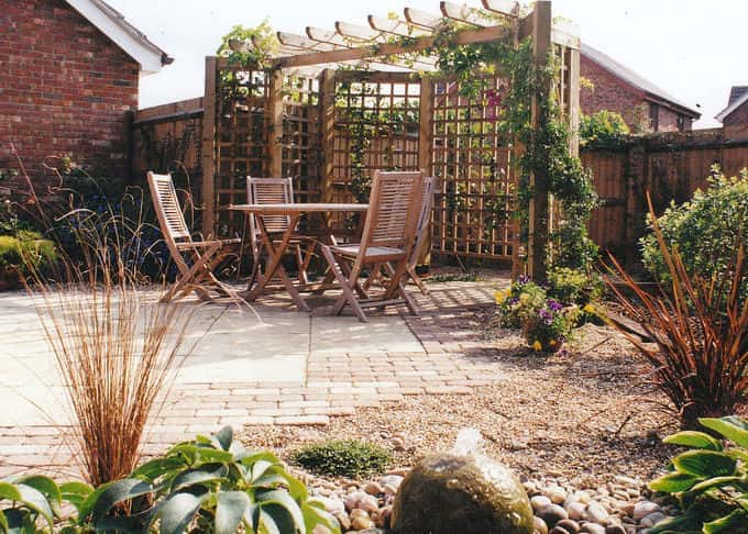 A variety of garden structures can be employed for privacy and protection