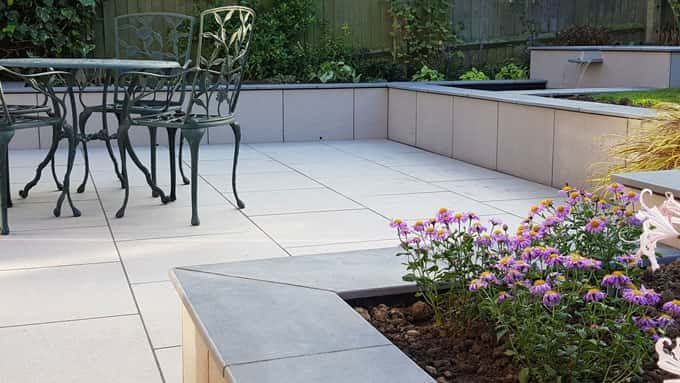 Porcelain cladding unifies walls, paving and water feature in a contemporary style