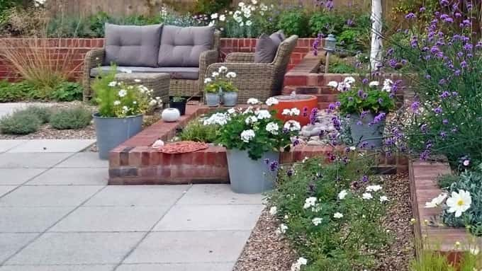 Raised beds of varying height create structural interest