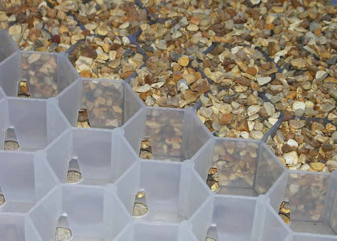 The gravel is contained within robust interlocking trays