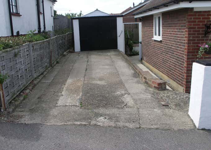 A conventional driveway in need of replacement