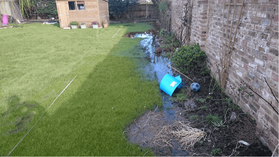 waterlogged garden in need of a drainage solution