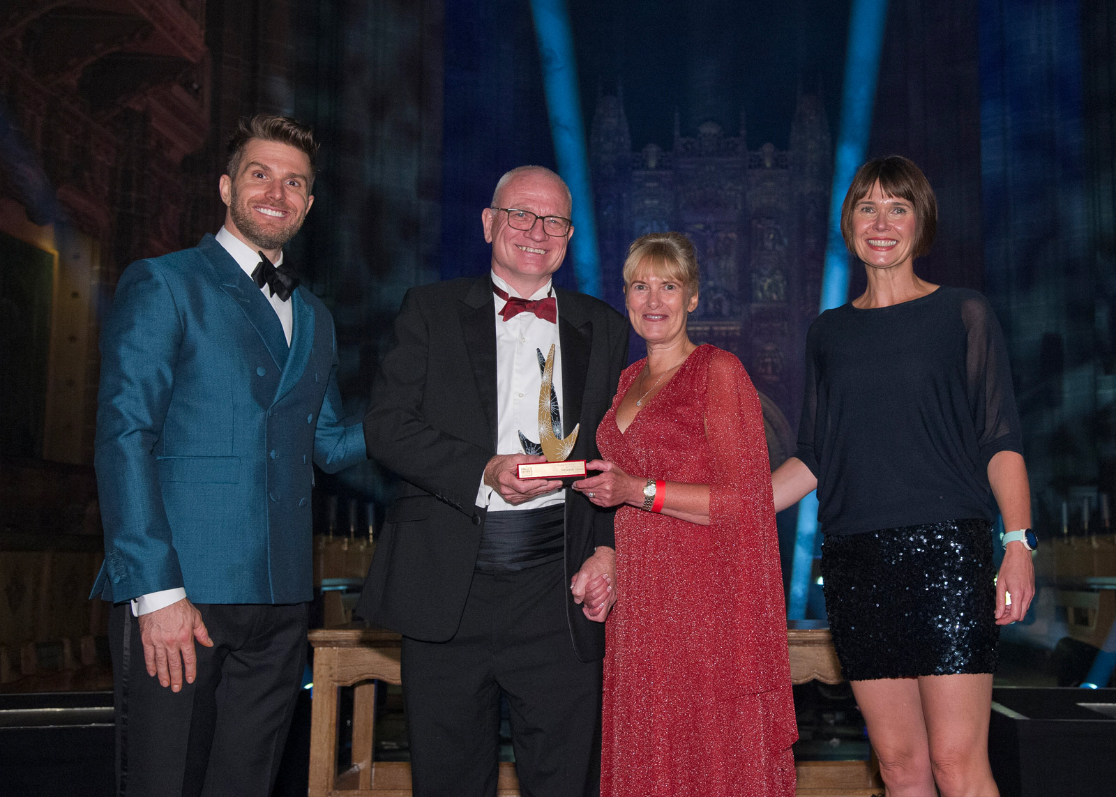 An image of The Myers Touch team winning the 'Kitchen Retailer of the Year' award at the kbbreview in Liverpool's Anglican Cathedral.