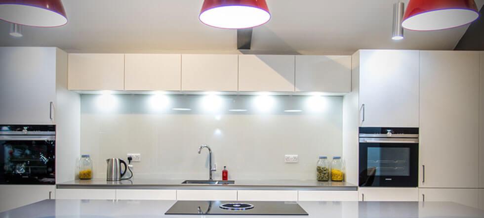 Streamlined white kitchen 12