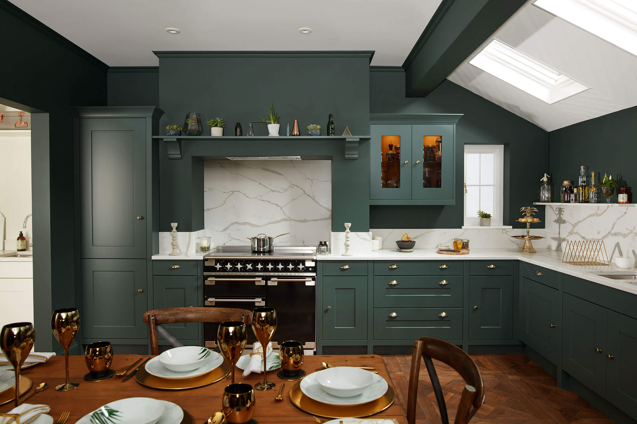 Green traditional kitchen with marble worktops