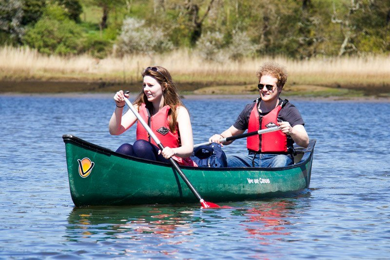 A couple doing some New Forest Canoeing.