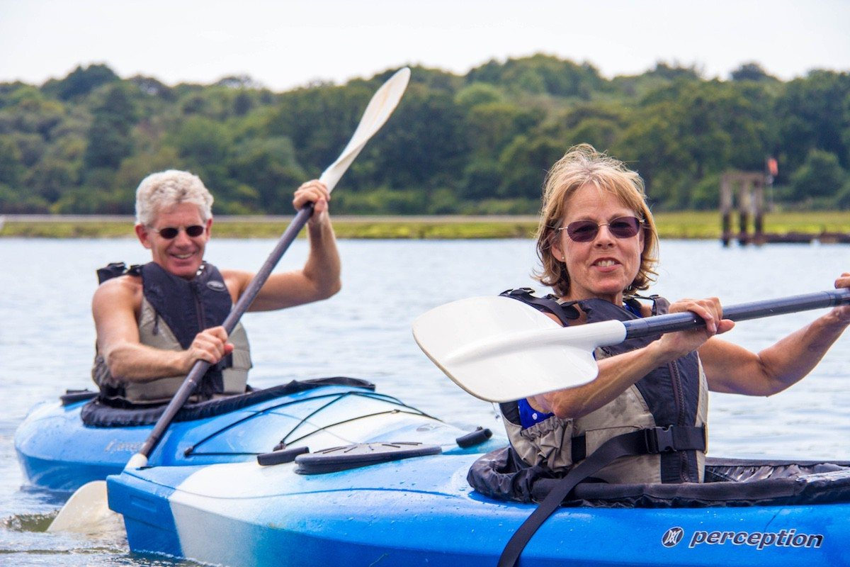 A couple taking part in a tour of the Beaulieu River in stable kayaks.
