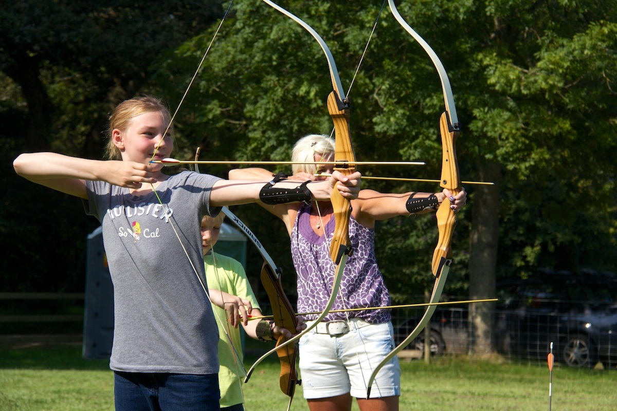 A mother and daughter taking part in a Family Archery session.