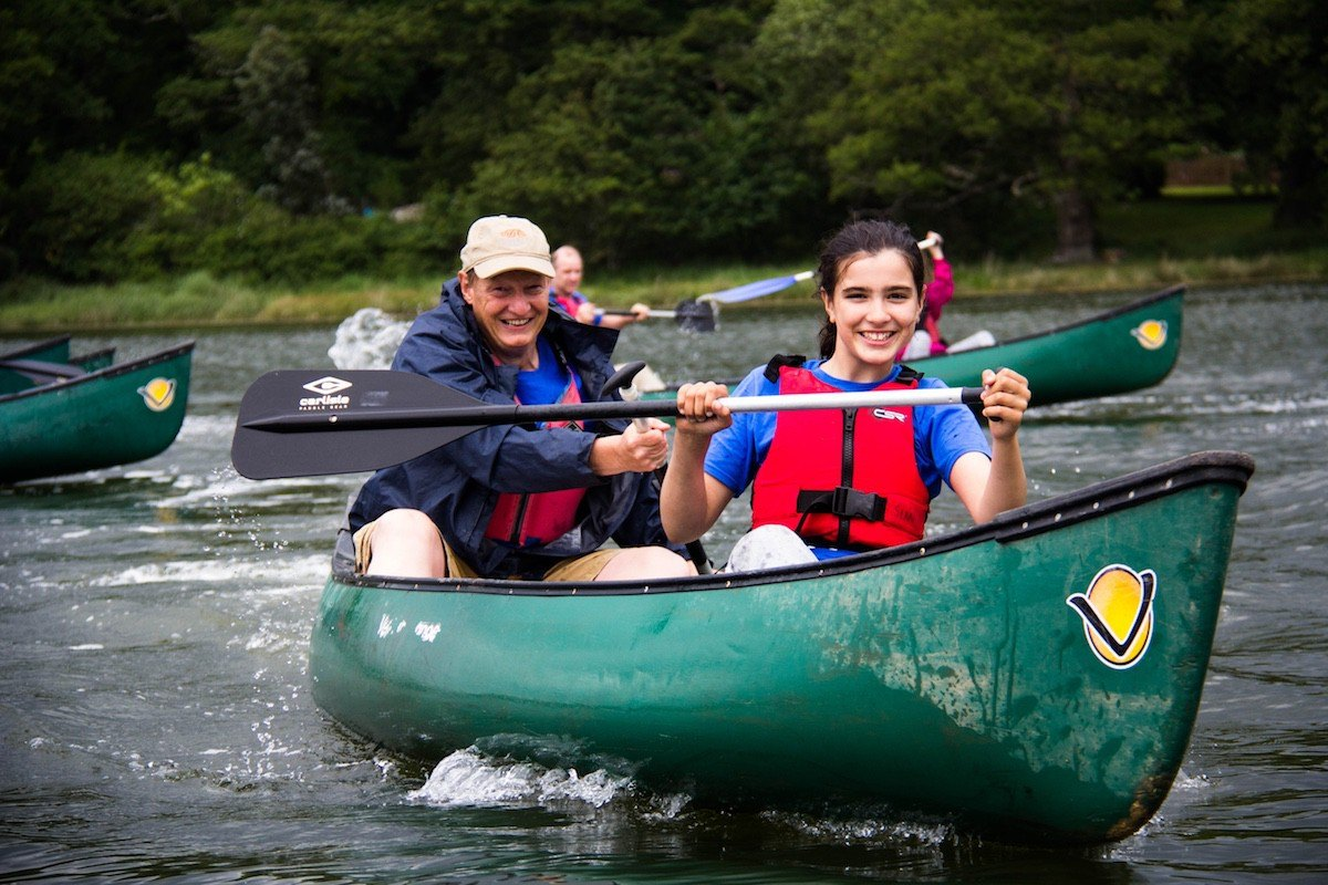 Youth activities include canoeing on the Beaulieu River.