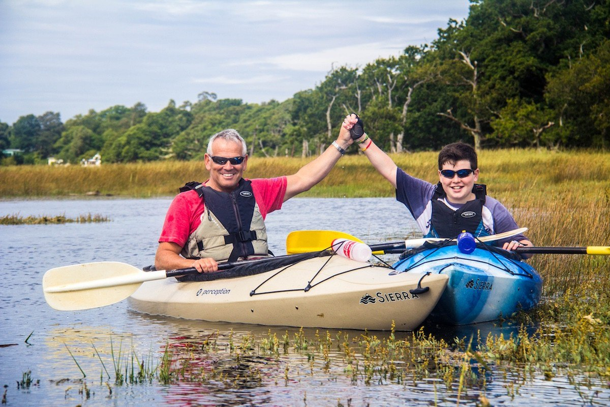 Father and son enjoying a kayaking taster on The Beaulieu River.