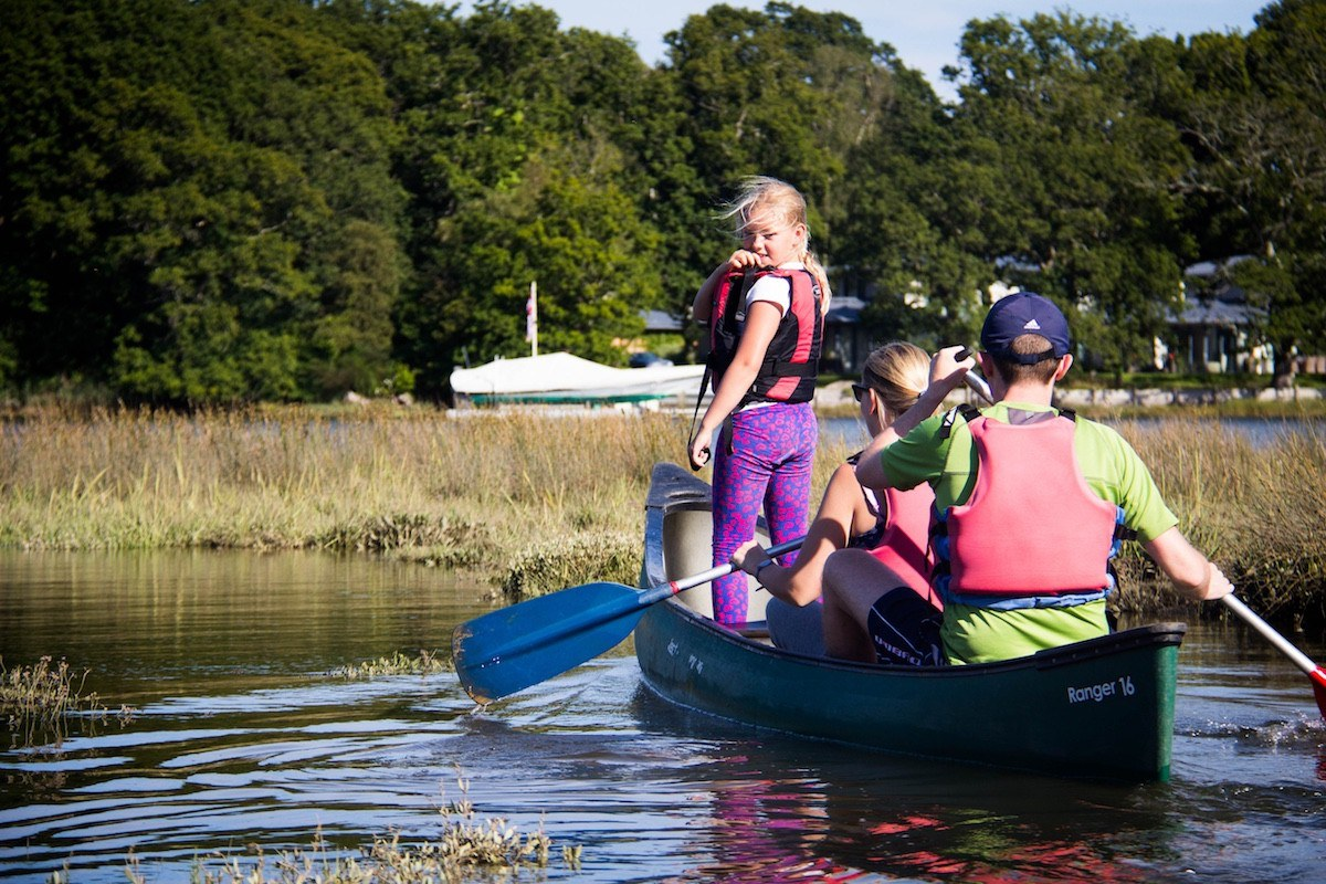 A young girl enjoying a family canoeing session with New Forest Activities.