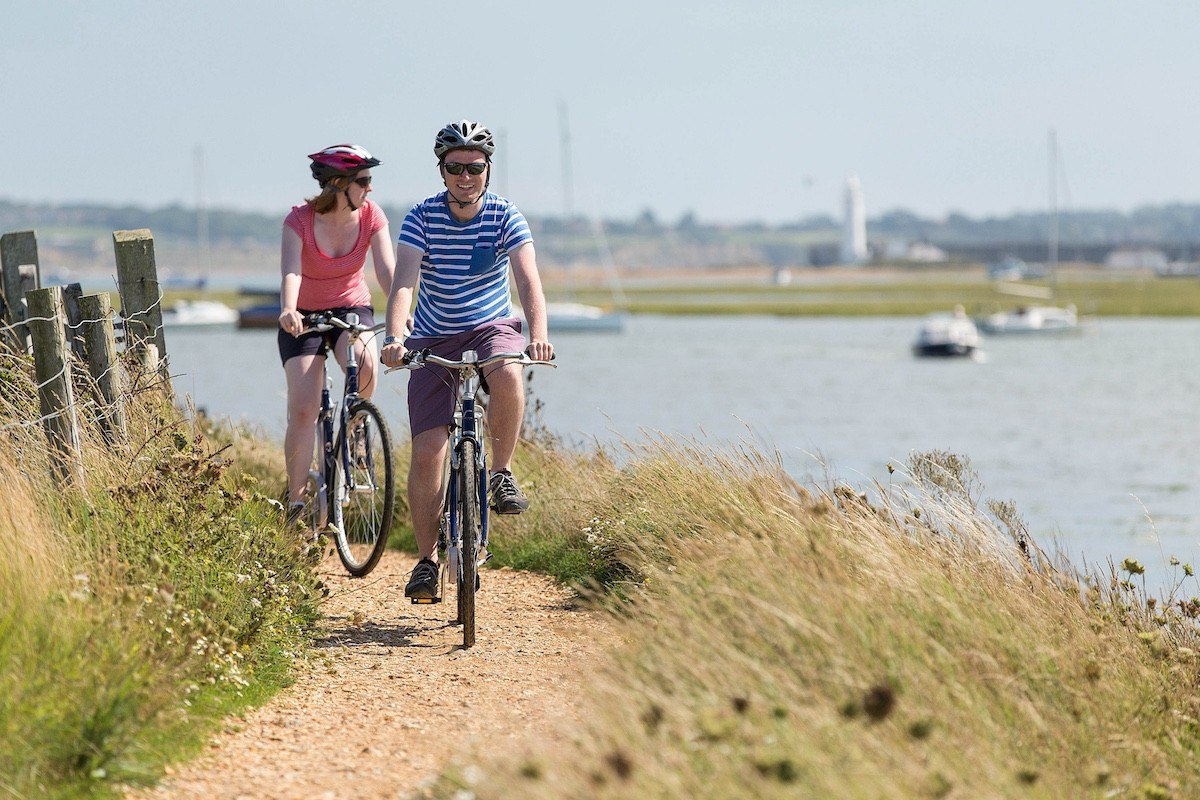A couple enjoying New Forest bike hire.