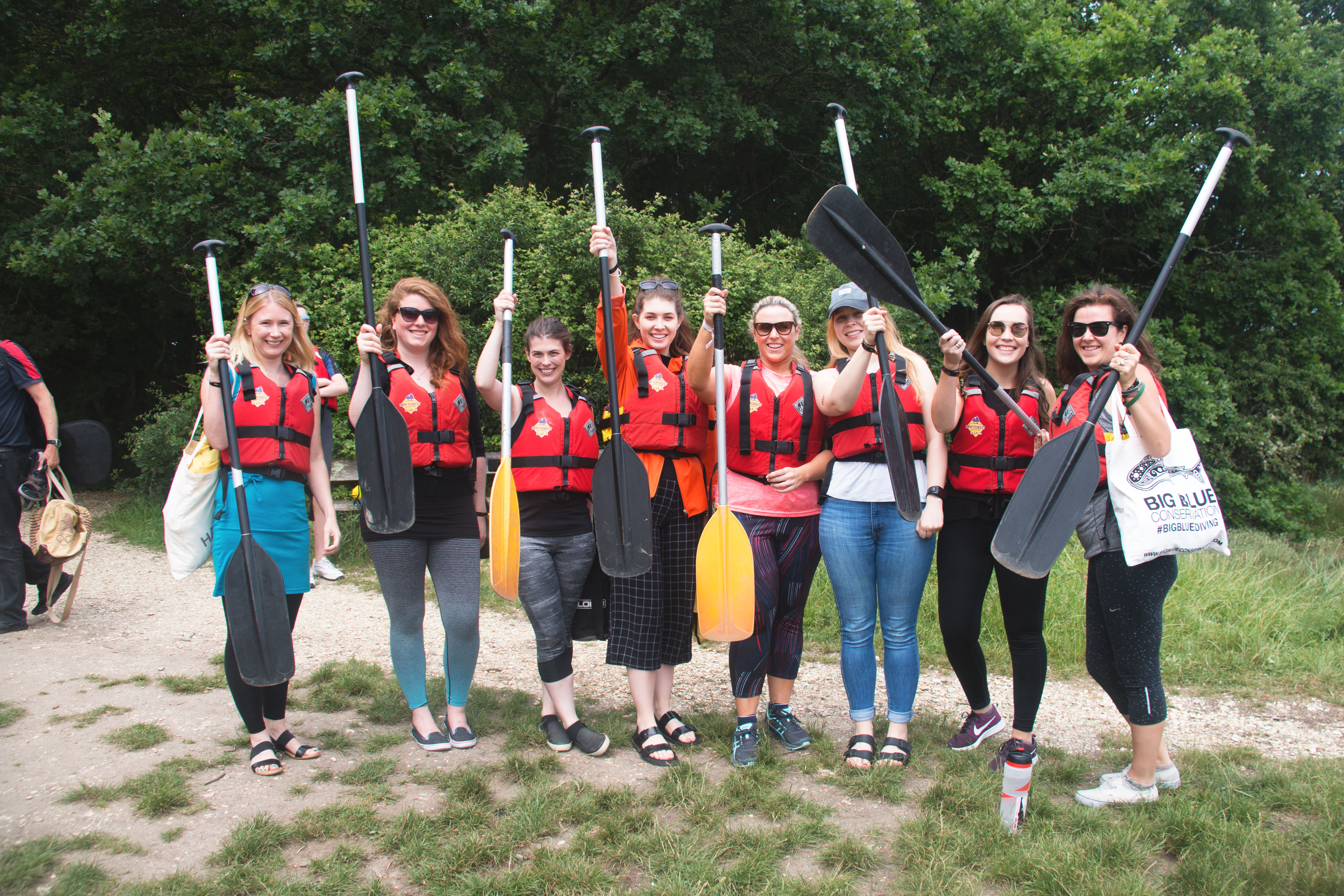 A group of girlfriends paddling to the pub after looking for fun activities for adults in The New Forest.