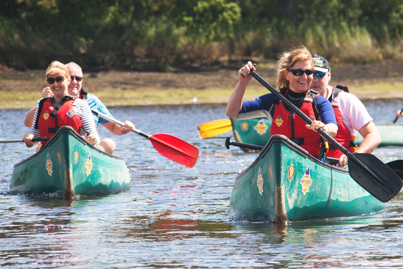 A group of friends enjoying private activities, canoeing on the Beaulieu River