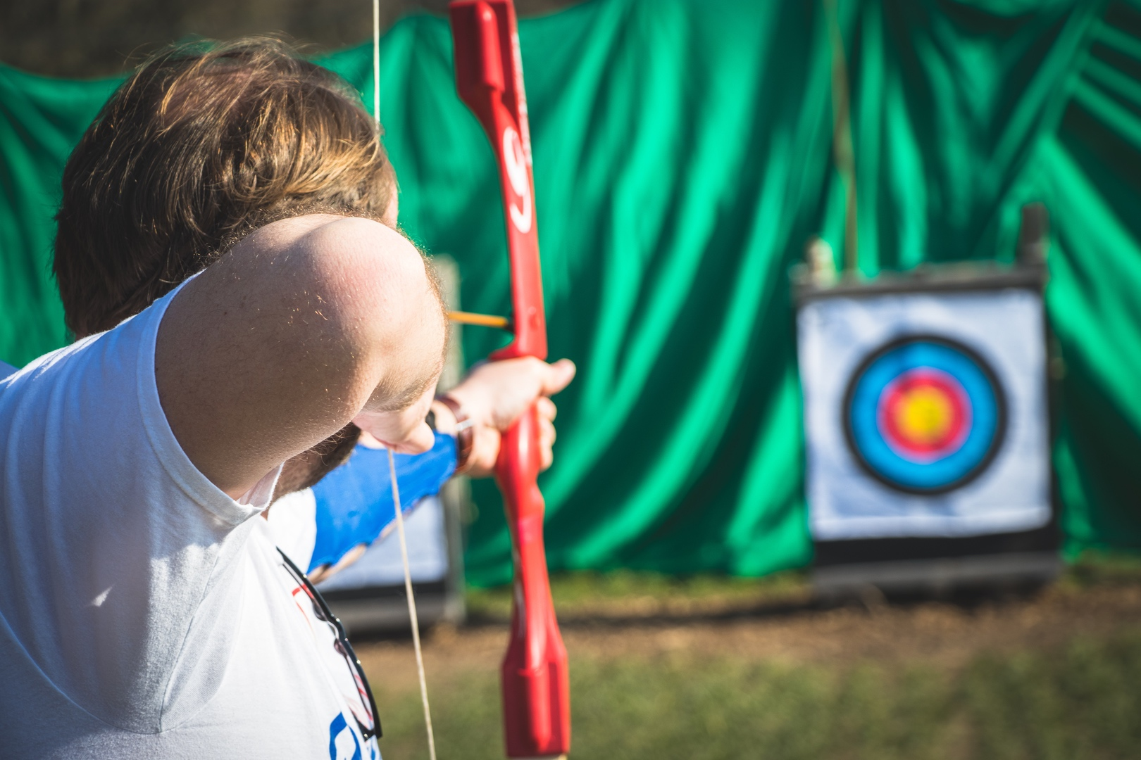 A man playing Archery after looking for fun activities for adults in The New Forest.