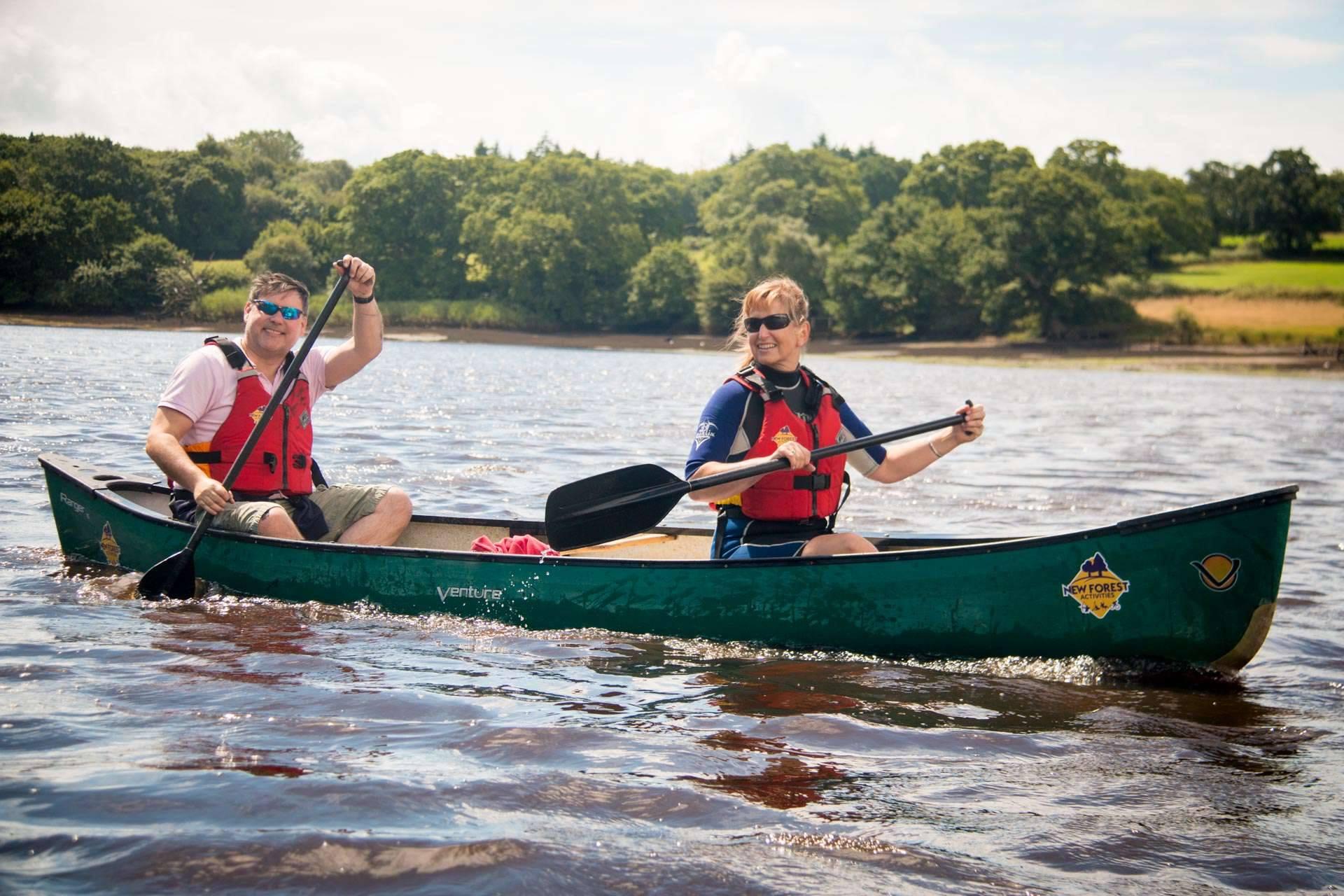 A couple enjoying their Beaulieu River tour.