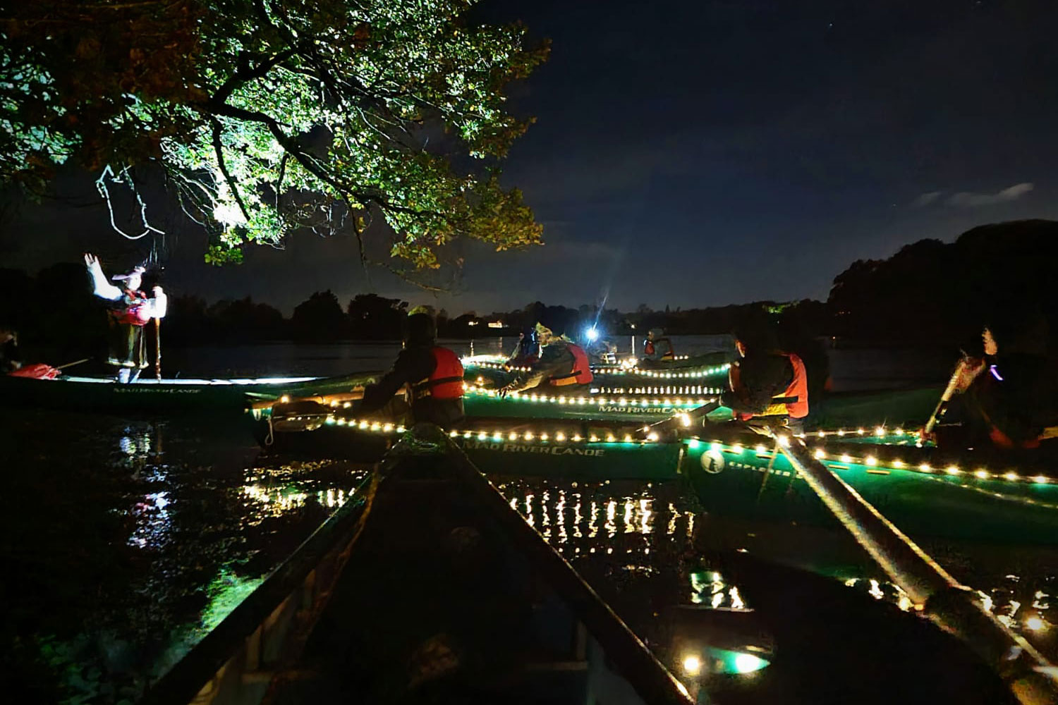 A group enjoying spooky tales on the Beaulieu River during a Spooky Halloween River Tour.