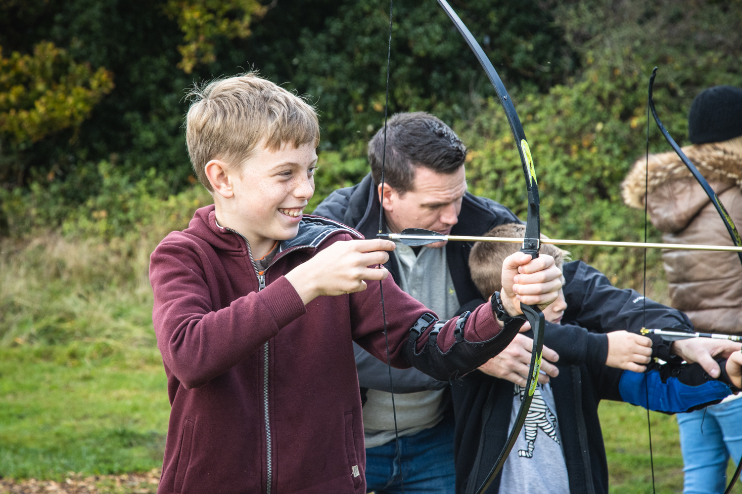 A young boy enjoying a some spooky themed fun during a Halloween Archery session.