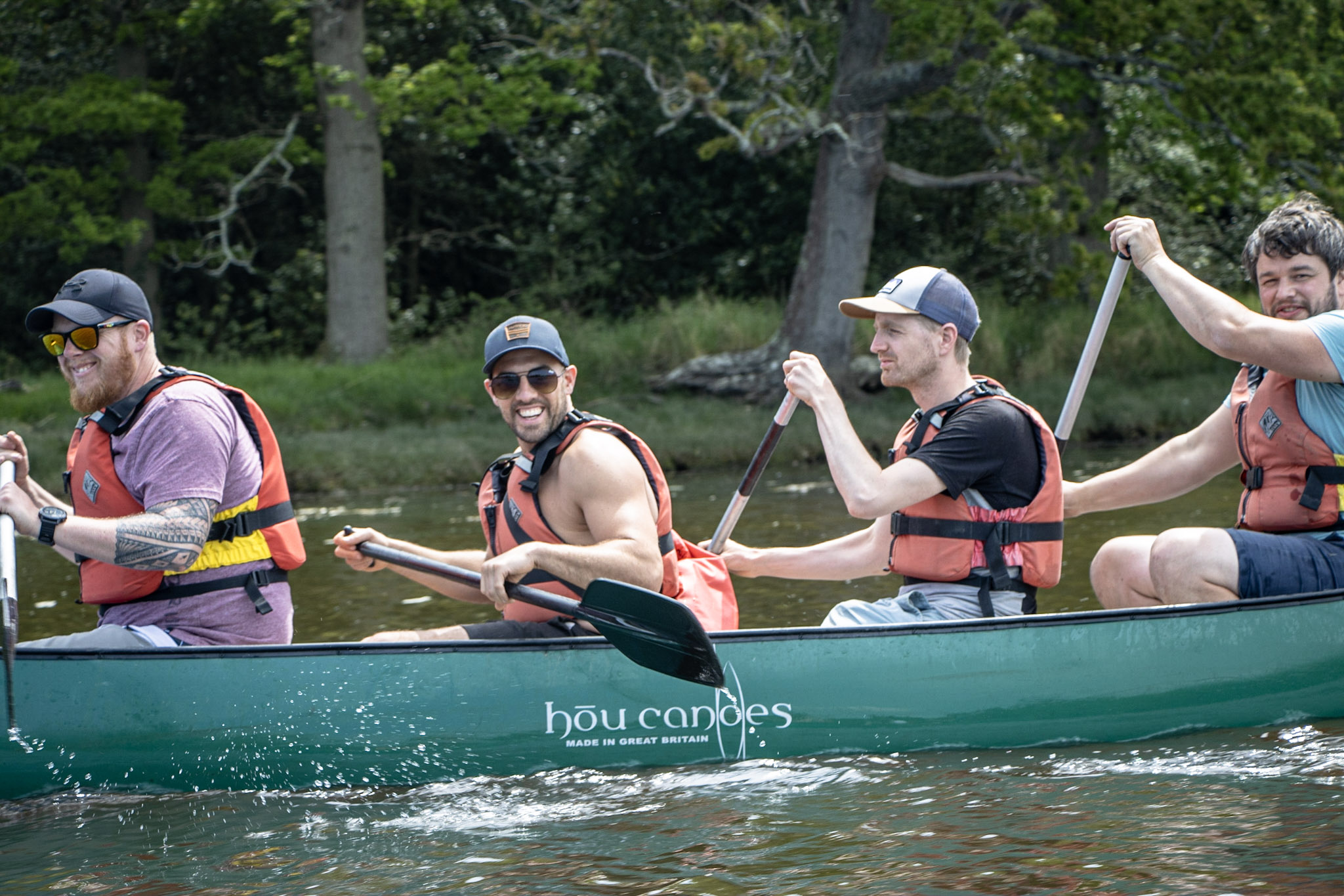 A group of women jumping into the Beaulieu River after their canoeing Hen Party with New Forest Activities