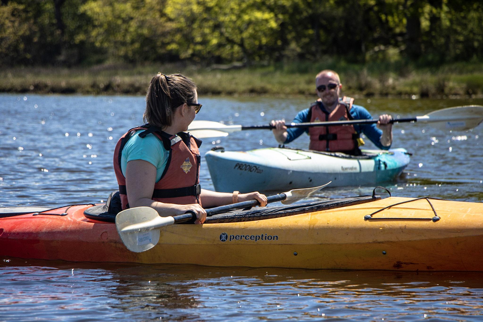A couple enjoying a guided kayaking tour on the Beaulieu River.