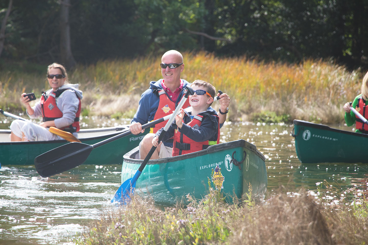 A Dad and his son enjoying a family canoeing session with New Forest Activities.